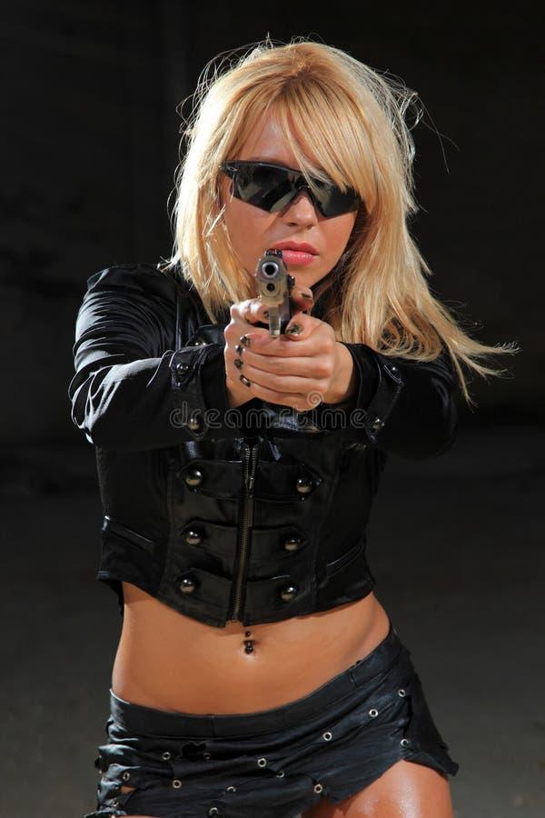 Beautiful girl with gun royalty free stock photos