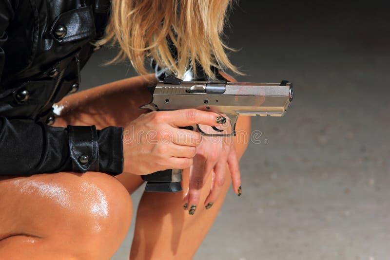 Beautiful girl with gun stock photos