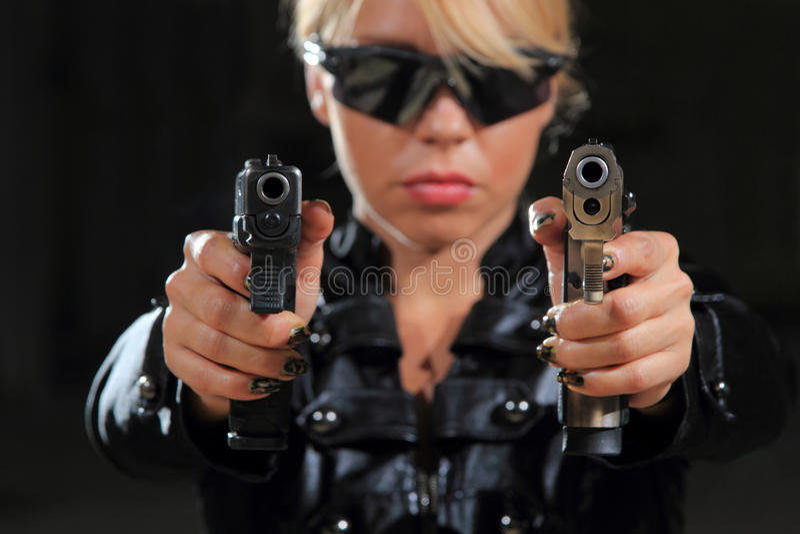 Beautiful girl with guns royalty free stock photo