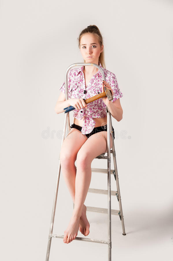 Download Beautiful And Girl. With Hammer Stock Photo - Image: 31881806