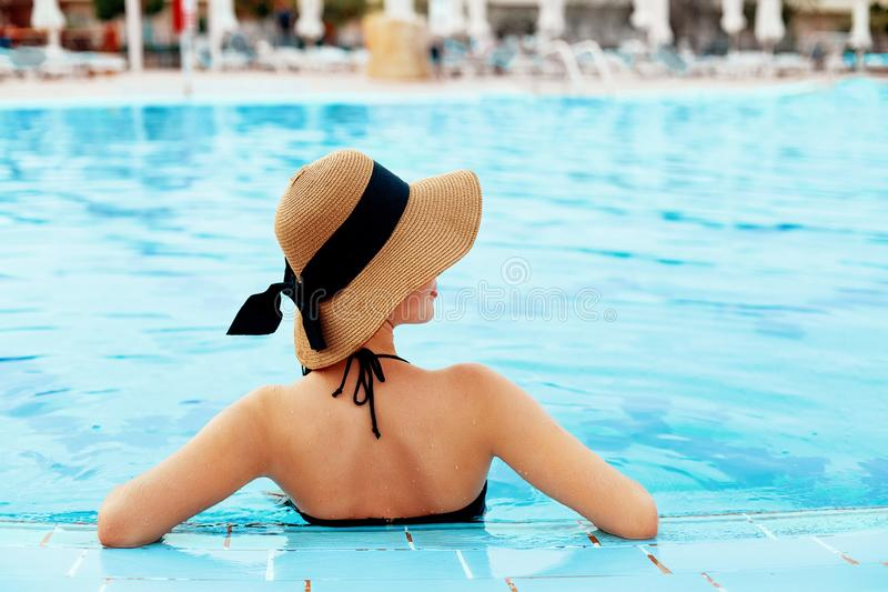 Beautiful Sexy Girl With Healthy Skin In  Bikini, Sun Hat Relaxing In Swimming Pool Water In Resort Spa Hote. L On Travel Holidays Vacation royalty free stock photography