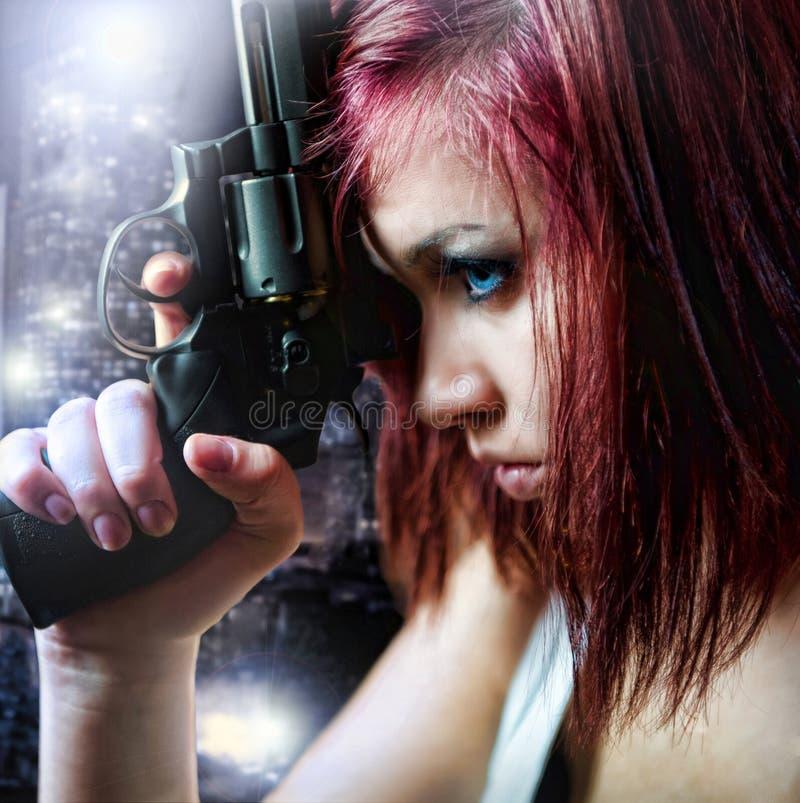 Beautiful girl holding gun royalty free stock photo