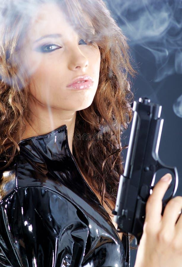 Beautiful girl holding gun royalty free stock photos