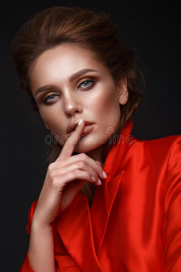 Beautiful girl with sensual lips, fashion hair,red dress and accessories. Beauty face. royalty free stock image
