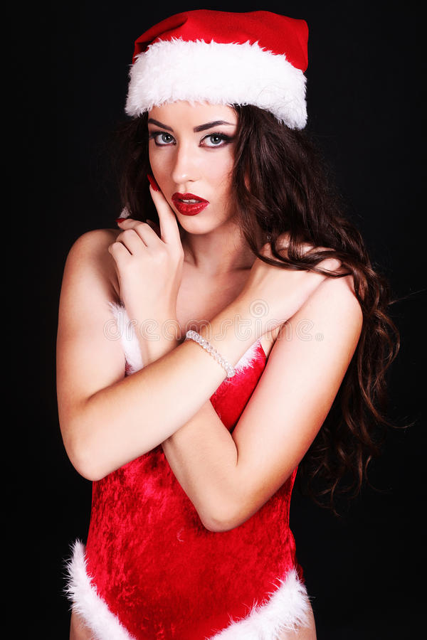 Download Beautiful Girl Wearing Santa Claus Clothes Stock Photo - Image of curly, adult: 27040426