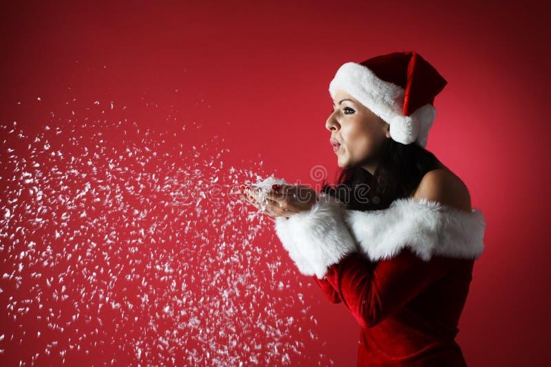 Beautiful girl wearing santa claus clothes stock photos