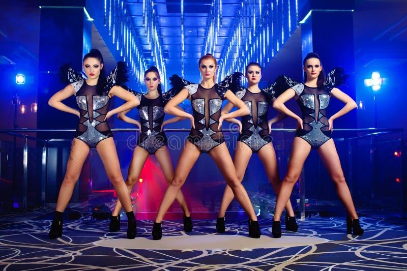 Beautiful go-go dancer girls posing at the nightclub stock image