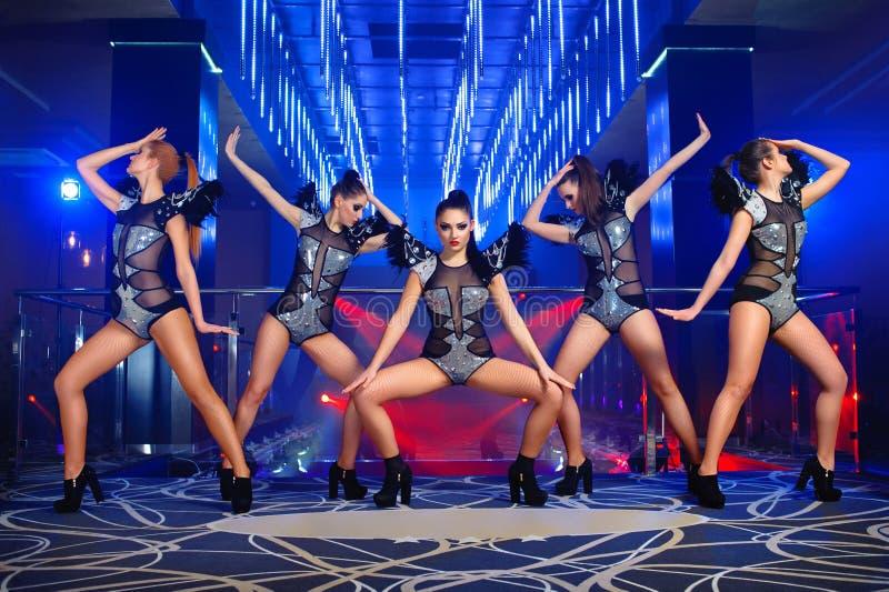 Beautiful go-go dancer girls posing at the nightclub stock photography