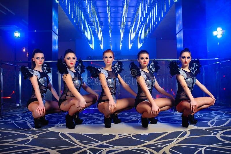 Beautiful go-go dancer girls posing at the nightclub stock photos