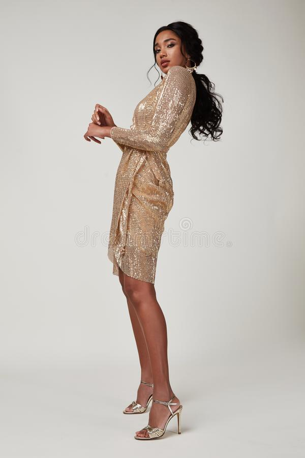 Free Beautiful Sexy Lady Fashion Pretty Woman Model Pose Wear Shine Gold Silk Shiny Dress Collection Clothes Style For Party Walk Skin Stock Photos - 165687163
