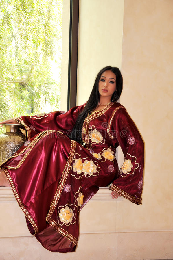 Beautiful lady in red oriental dress royalty free stock photo