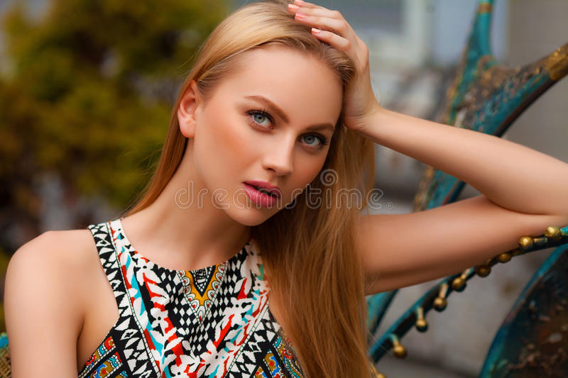 Beautiful woman with blond hair posing outdoor. Fashion girl portrait.  royalty free stock images