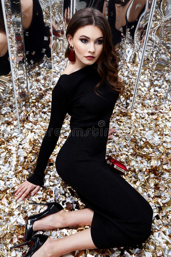 Beautiful woman brunette hair evening makeup pretty face we. Ar luxury black dress skinny fit style celebrate party holiday Christmas New Year mirror shiny stock images