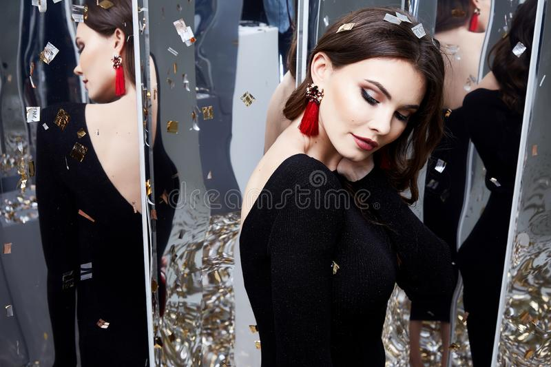 Beautiful woman brunette hair makeup cosmetic for face wear. Luxury clothes elegant dress style for celebrate party holiday Christmas New Year mirror shiny royalty free stock photo