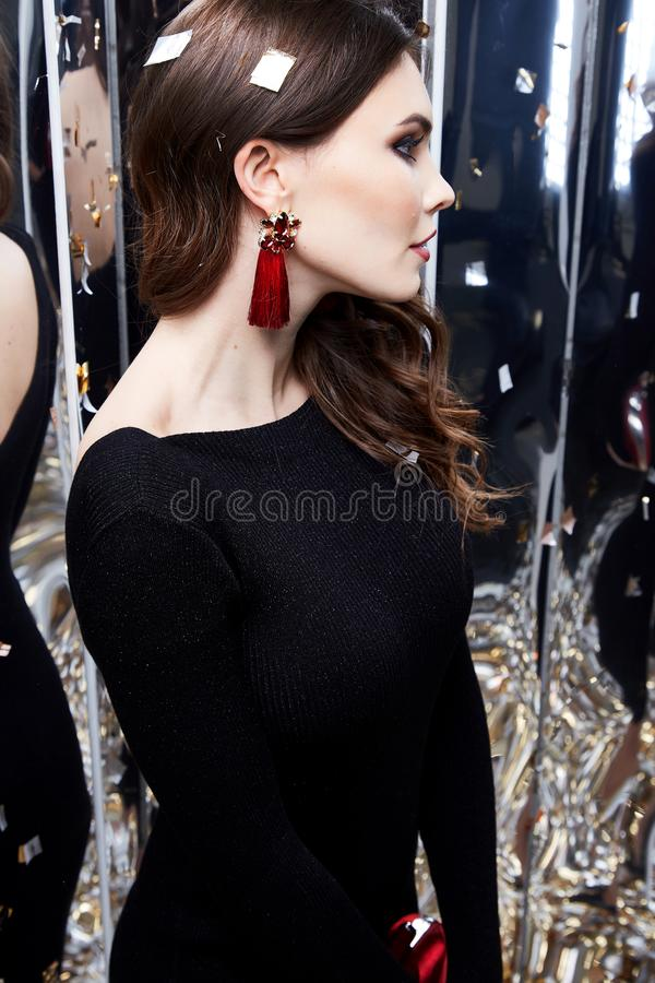 Beautiful woman brunette hair makeup cosmetic for face wear. Luxury clothes elegant dress style for celebrate party holiday Christmas New Year mirror shiny royalty free stock image