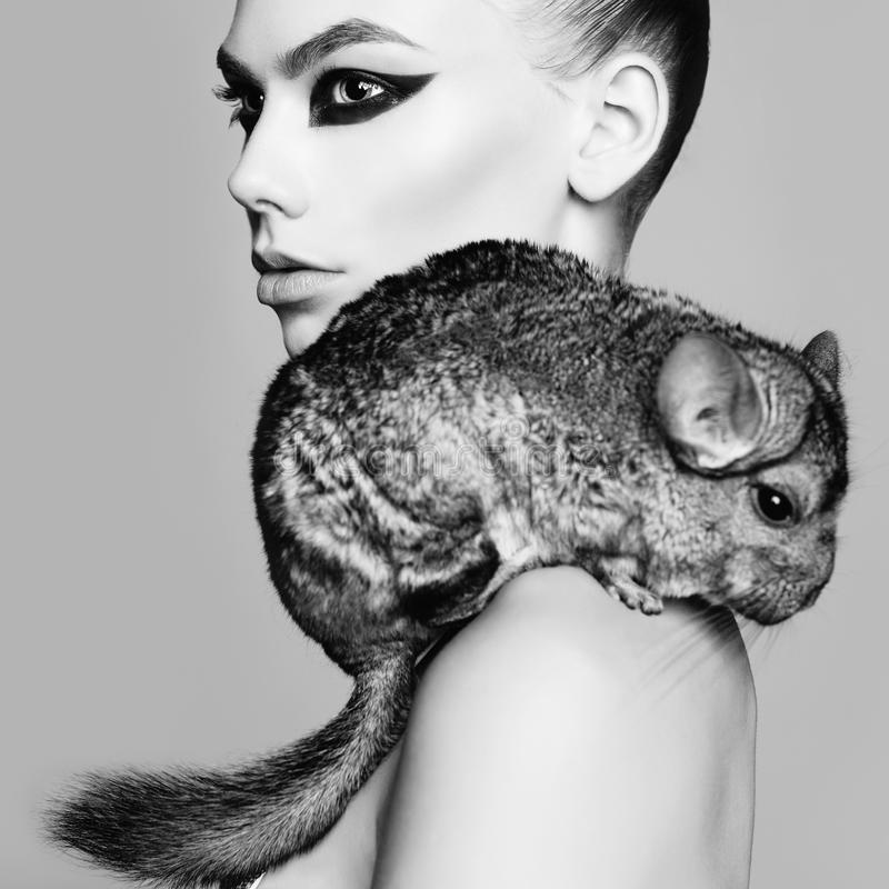 Beautiful woman with chinchilla royalty free stock image
