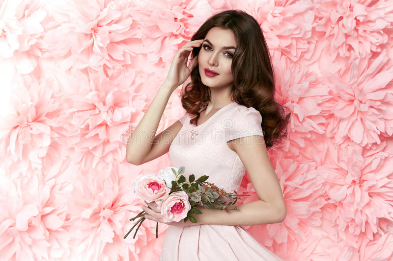 Beautiful woman in dress many flowers makeup summer spring stock photography