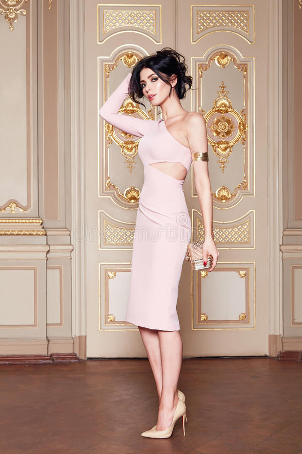 Beautiful woman in elegant dress fashionable autumn Collection of spring long brunette hair makeup tanned slim body figure ac. Cessories interior luxury castle stock photos