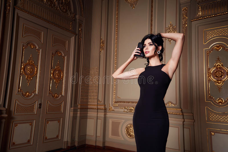 Beautiful woman in elegant dress fashionable autumn Collection of spring long brunette hair makeup tanned slim body figure ac stock photo