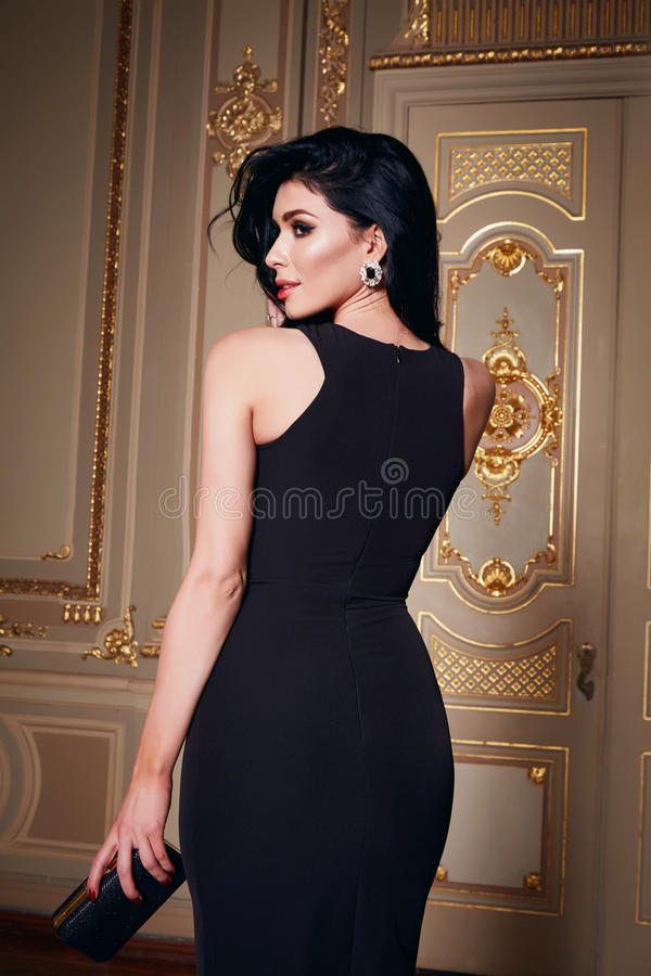 Beautiful woman in elegant dress fashionable autumn Collection of spring long brunette hair makeup tanned slim body figure ac royalty free stock photography