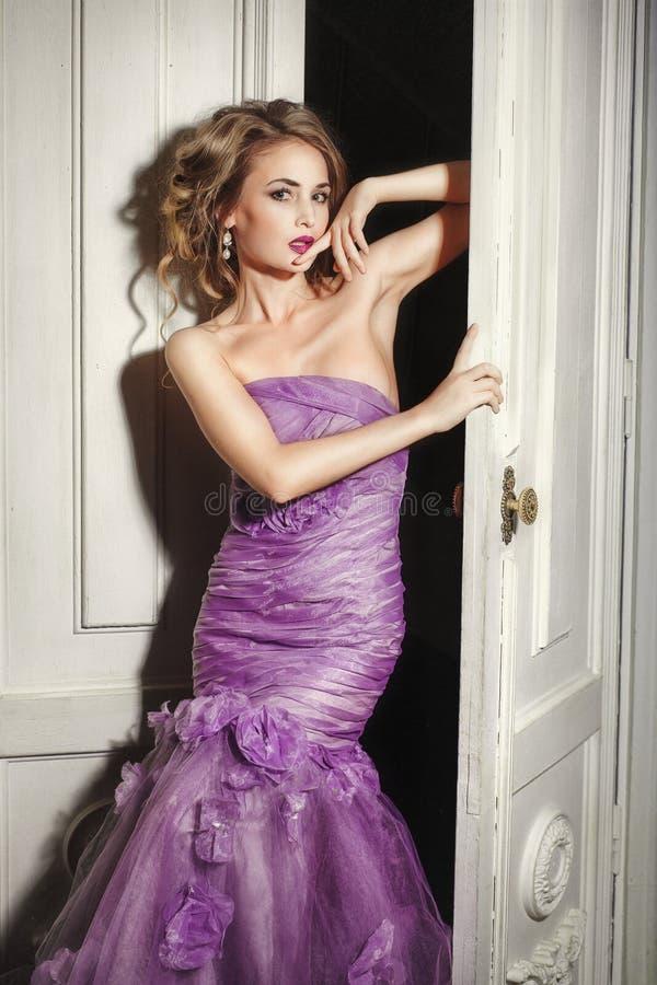 Beautiful woman in elegant purple dress. royalty free stock photos