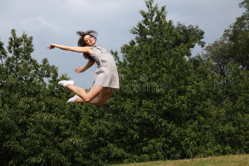 Beautiful woman flying jump for fun success royalty free stock photos