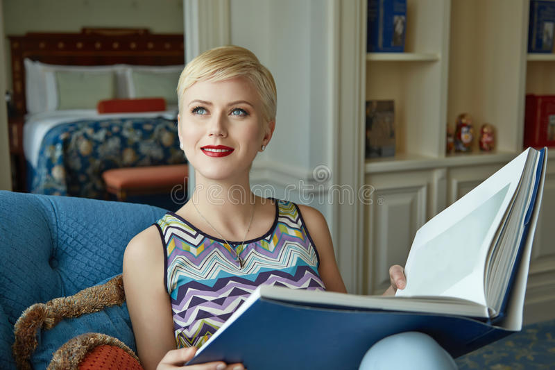 Beautiful woman luxary dress jewelry make-up interior stock photo