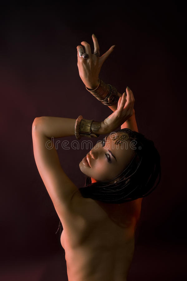 Beautiful Woman With Luxury glossy gold eastern Makeup danc royalty free stock image