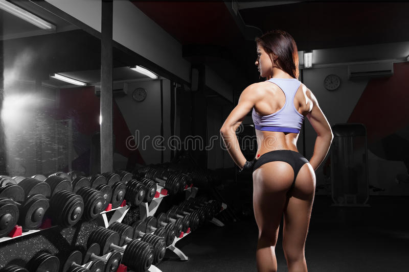 Beautiful woman with perfect abdominal muscles at the gym royalty free stock photos