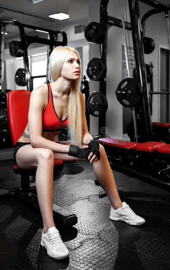 Beautiful woman with perfect abdominal muscles at the gym royalty free stock photo