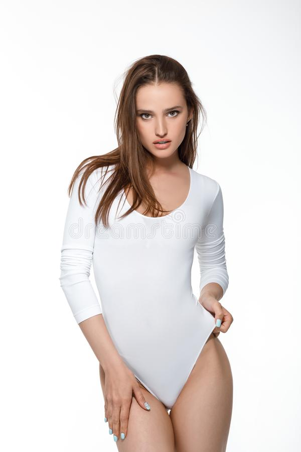 Beautiful woman with perfect body in white bodysuit stock images