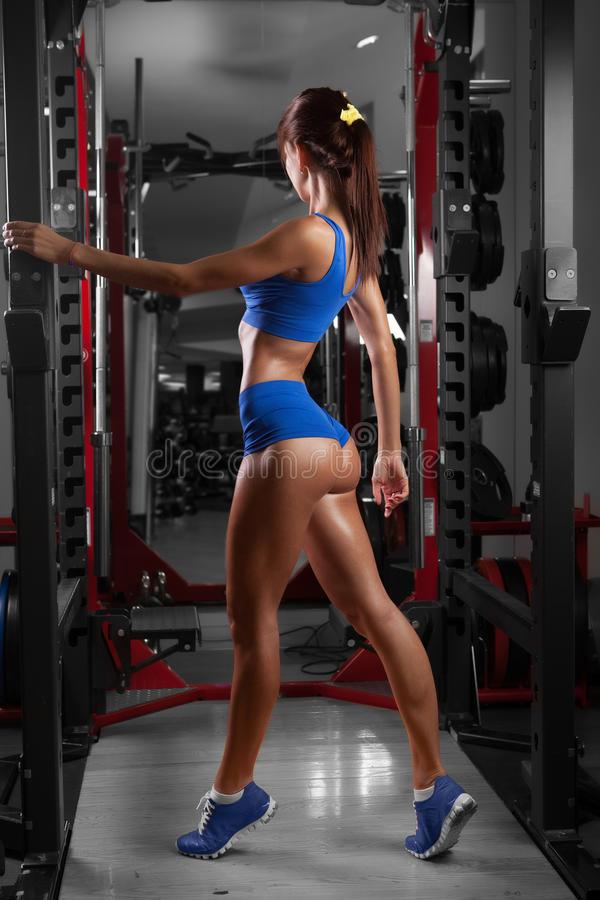 Beautiful woman with perfect buttocks at the gym royalty free stock image