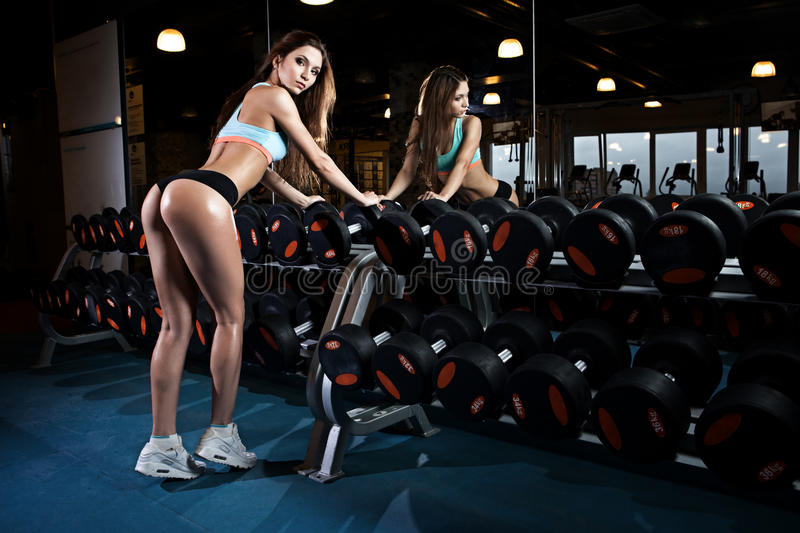 Beautiful woman with perfect buttocks at the gym stock image
