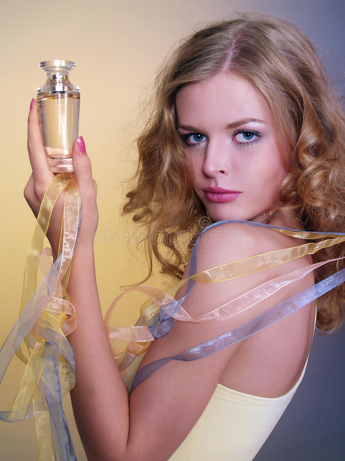 Beautiful and woman with perfume stock image