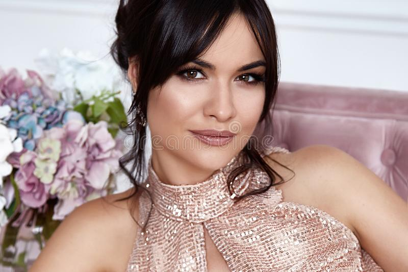 Beautiful sexy woman portrait close up brunette hair do beauty salon perfume cosmetic skin care make up lashes blossom bouquet stock photo