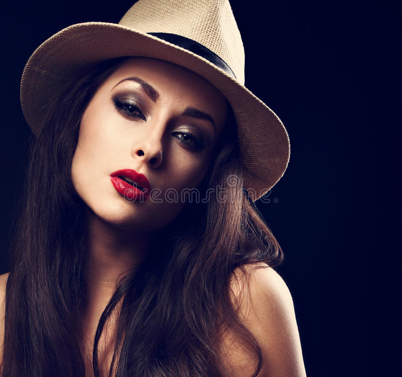 Beautiful woman posing in cowboy summer hat with bright red stock photography