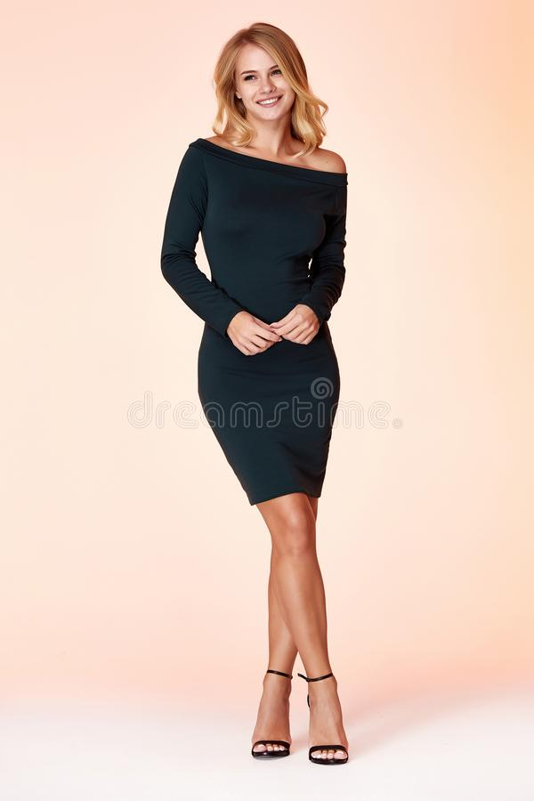 Beautiful sexy woman pretty face long blond hair wear green color skinny dress fashion style clothes party walk fall collection royalty free stock images