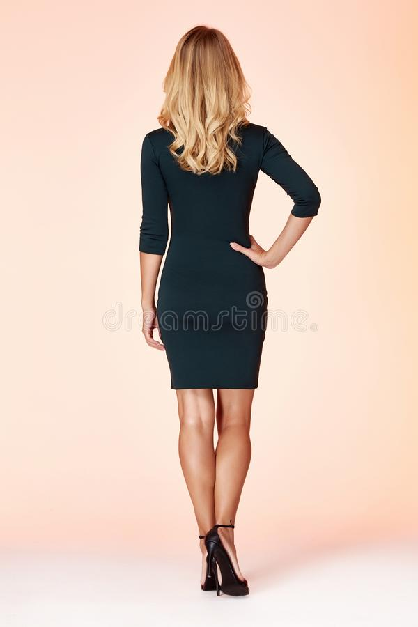 Free Beautiful Sexy Woman Pretty Face Long Blond Hair Wear Green Color Skinny Dress Fashion Style Clothes Party Walk Fall Collection Stock Photos - 148131823
