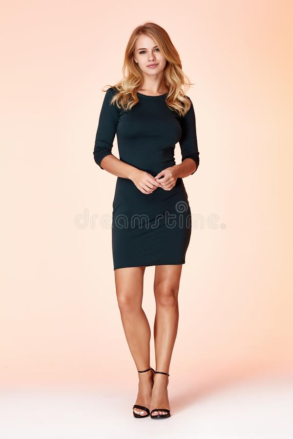 Free Beautiful Sexy Woman Pretty Face Long Blond Hair Wear Green Color Skinny Dress Fashion Style Clothes Party Walk Fall Collection Royalty Free Stock Image - 148131926