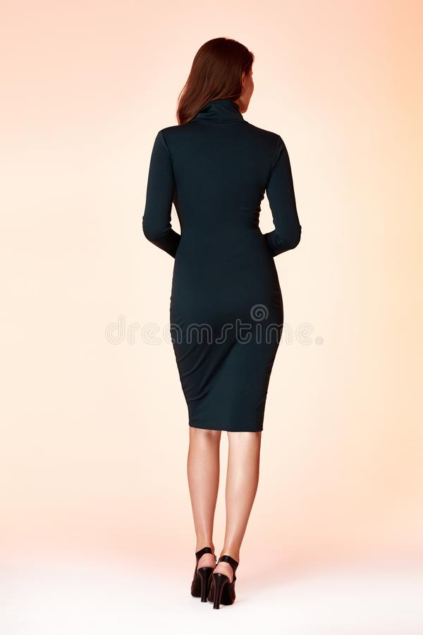 Beautiful woman pretty face long brunette hair wear green c. Olor skinny dress fashion style clothes party walk fall collection accessory jewelry earrings stock photos