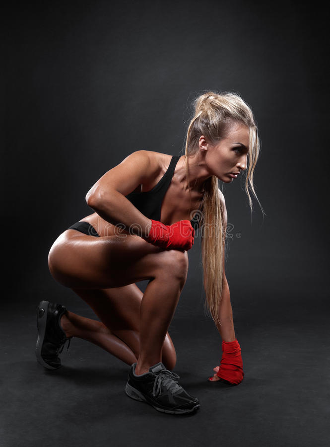 Beautiful woman in red boxing bandages royalty free stock photos
