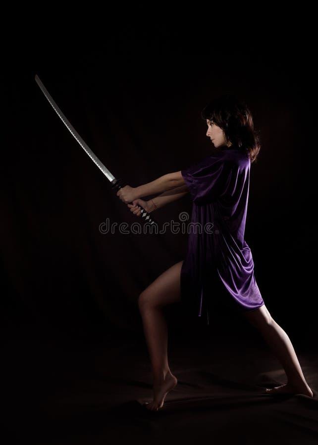 Beautiful woman with samurai sword. woman with katana.  stock images