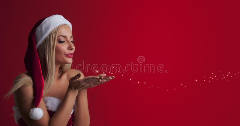 Santa woman blowing fairy dust royalty free stock photo