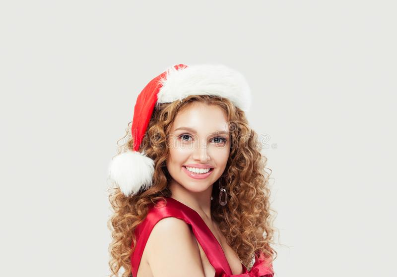 Beautiful sexy woman in Santa hat on white background royalty free stock photos