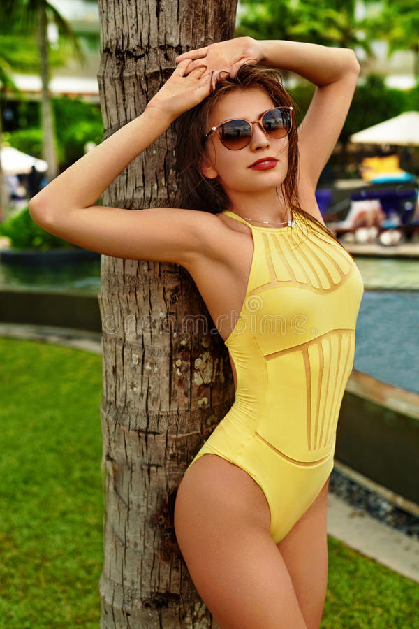 Beautiful Woman In Swimsuit Posing. Beauty Girl. Summer relax royalty free stock photography