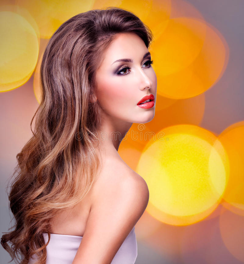 Beautiful woman with wavy long hair and red lips royalty free stock photography