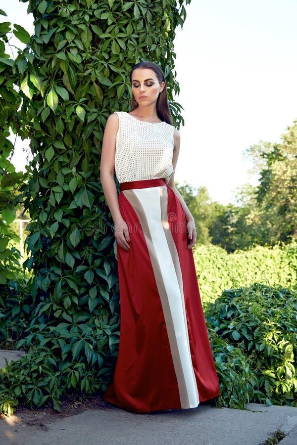 Beautiful woman wearing dress walk park sun shine makeup royalty free stock photo