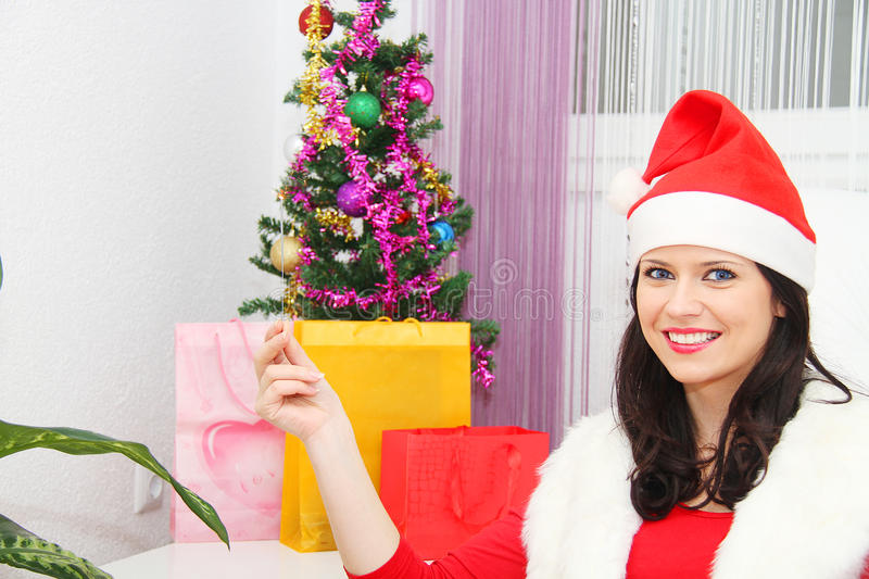 Beautiful and woman wearing santa clause costume. Photo of the Beautiful and woman wearing santa clause costume royalty free stock images