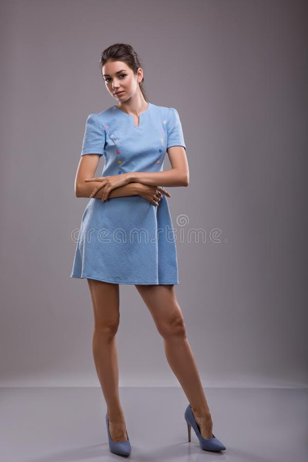 Beautiful young business woman brunette hair evening makeup wearing blue dress business clothes for meetings walks royalty free stock photos