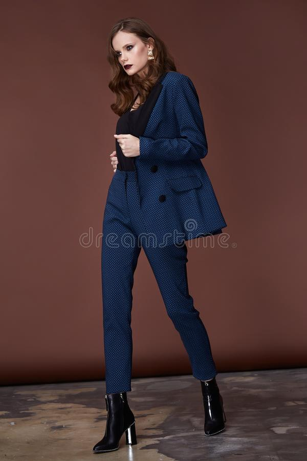 Beautiful young business woman dark hair evening makeup wearing formal suit jacket pants high heels shoes business clothes. For meetings walks autumn spring stock photos